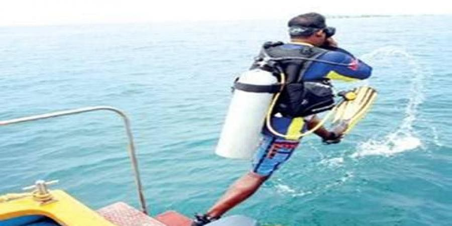 Aeron Fernandes, a diving instructor, gives a demo to mediapersons off the shore of Kaup beach on Sunday