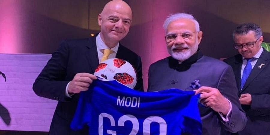 FIFA President Infantino gifts PM Narendra Modi custom-made G20 football jersey