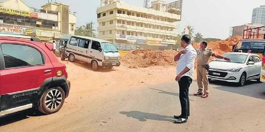 District minister U T Khader manages traffic near Pumpwell junction, Mangaluru, on Saturday