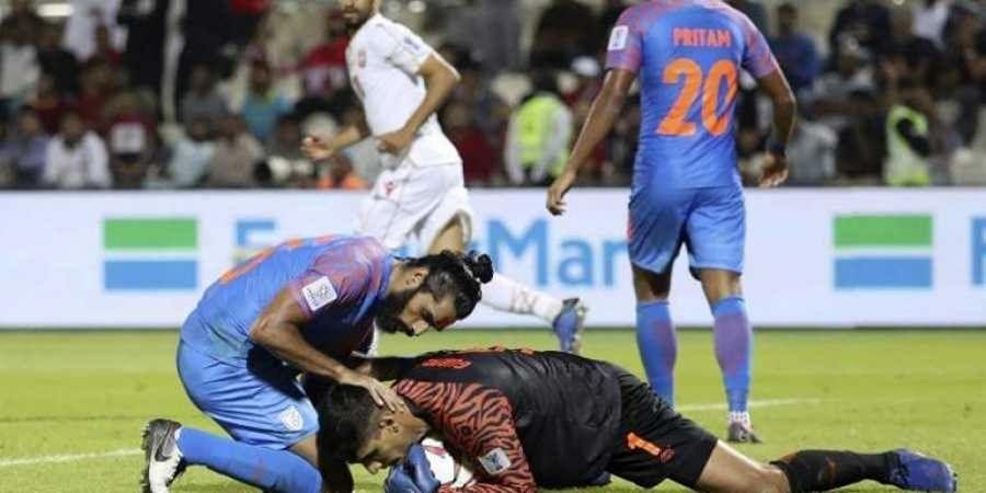 India's defender Sandesh Jhingan  protects India's goalkeeper Gurpreet Singh Sandhu