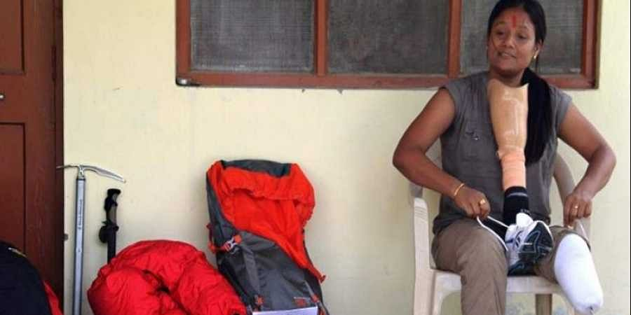 Indian mountaineer Arunima Sinha prepares her equipment at her residence in Lucknow.