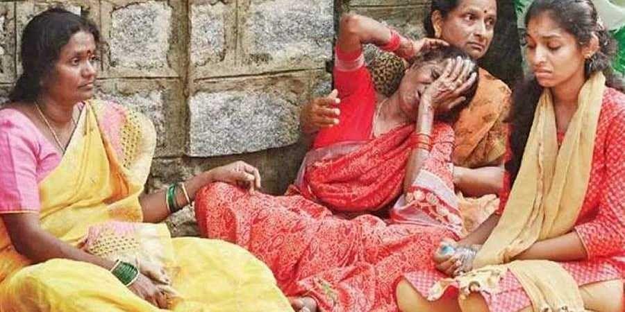 Ramesh's relatives mourn at the Jnanabharathi campus