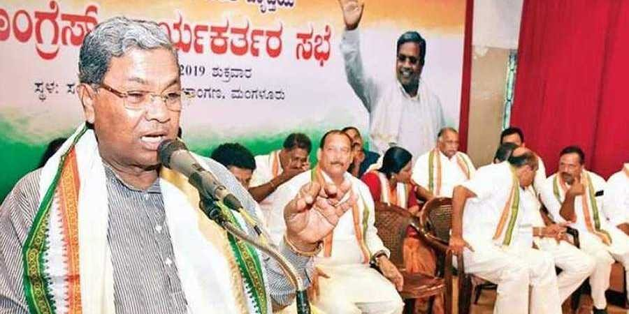 ormer CM Siddaramaiah addresses a Cong workers conference  in Mangaluru