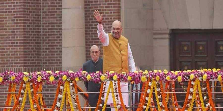 Amit Shah wave at people