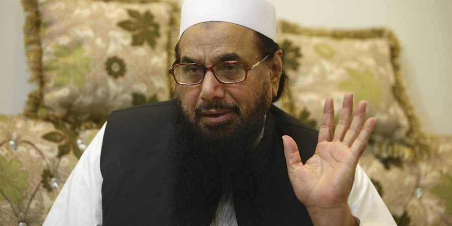 By seeking 'pocket money' for Hafiz Saeed, Pakistan only showed its duplicity: MEA
