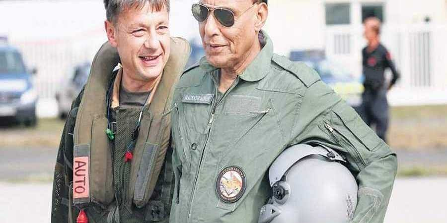 Defence Minister Rajnath Singh with Dassault Aviation chief pilot Philippe Duchateau