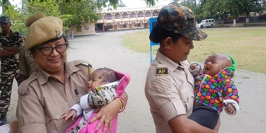 PolicePerson_with_baby