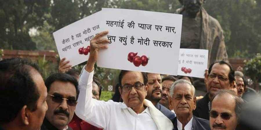 P Chidambaram with Congress MPs protesting against the Onion price hike at Parliament house in New Delhi on Thursday.