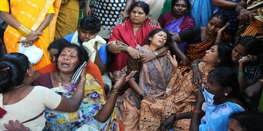 An inconsolable Kalavathi, wife of martyr CRPF jawan H Guru (right), and other family members at Gudigere village in Mandya district on Friday