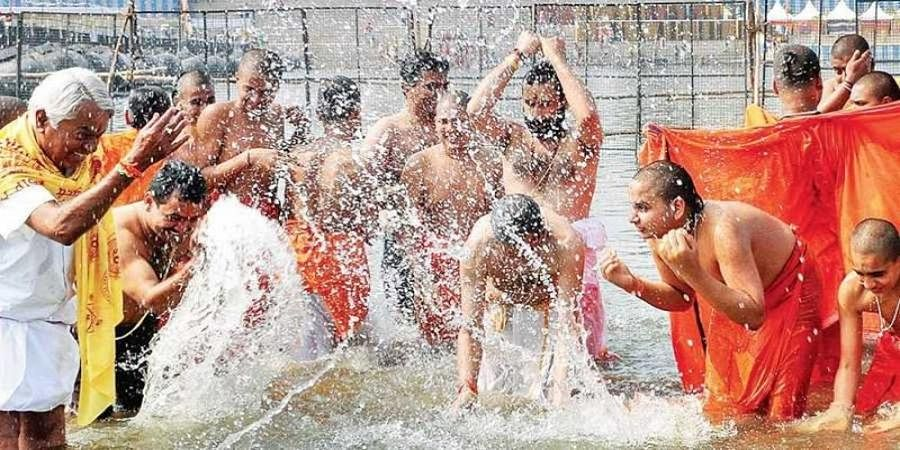 Devotees take a dip at the on-going Kumbh Mela