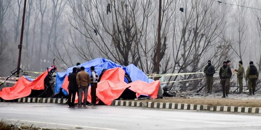 Security agencies inspect the site of suicide bomb attack at Lethpora area in Pulwama district of south Kashmir.
