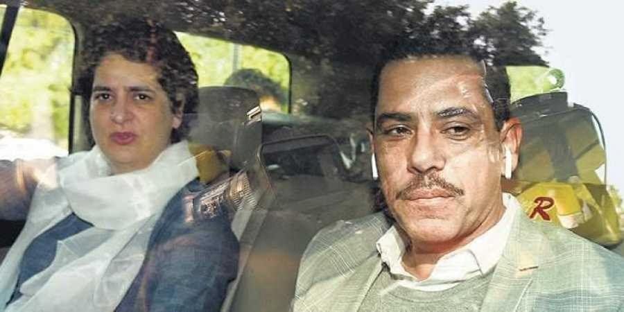 Congress leader Priyanka Gandhi Vadra with husband Robert Vadra outside the Enforcement Directorate's office, in New Delhi on Wednesday