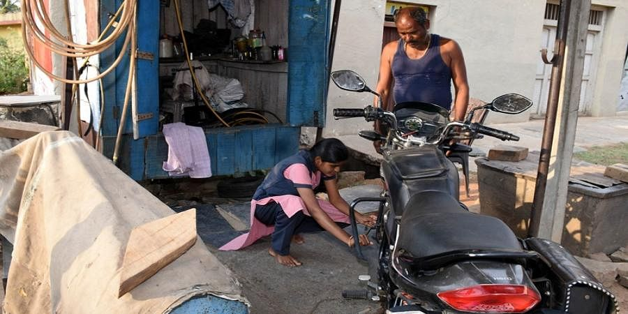 Kusuma in fathers puncture shop