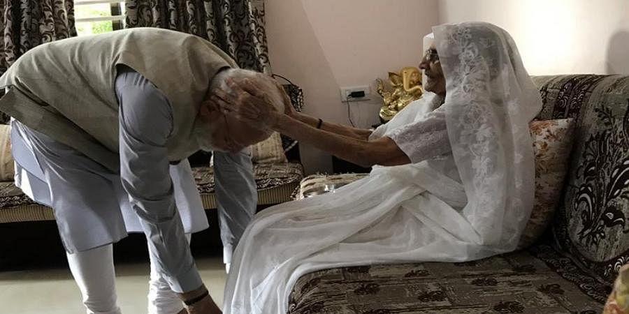 PM Narendra Modi met mother Hiraben and seek her blessings