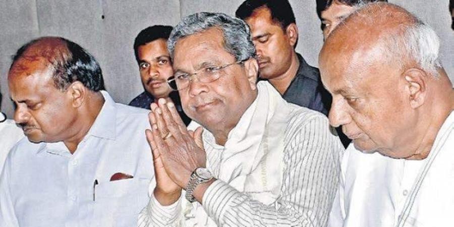 CM HD Kumaraswamy, Congress leader Siddaramaiah and JD(S)patriarch HD Deve Gowda at a press conference (File| Pandarinath B)