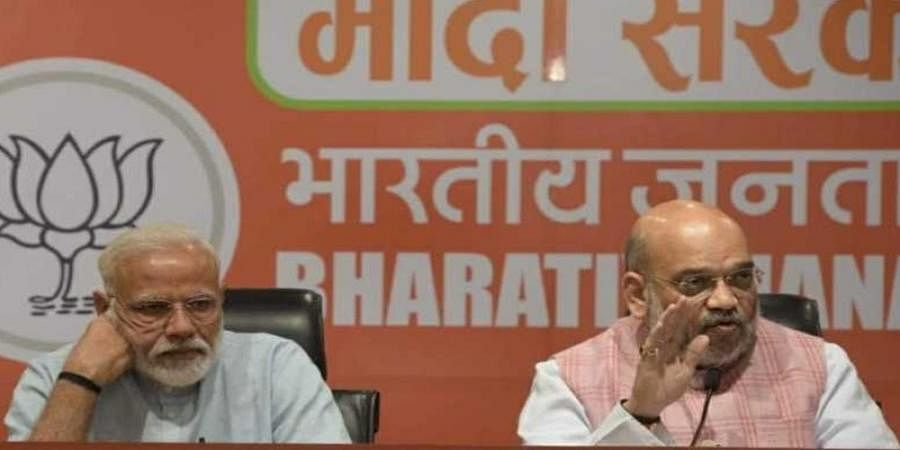We'll return with a bigger majority, declare Modi, Shah at joint briefing