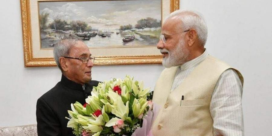 Modi meets Pranab Mukherjee, seeks blessings ahead of taking charge as PM for second time