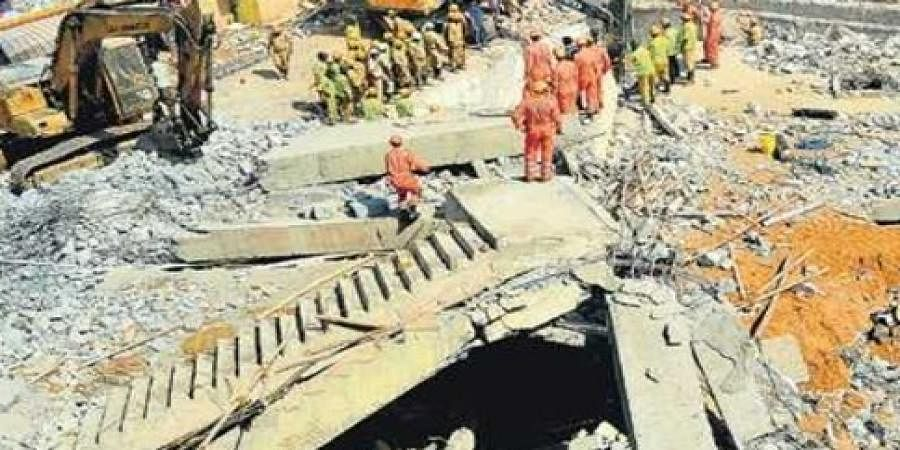 File pictures of the building which collapsed in Dharwad in March