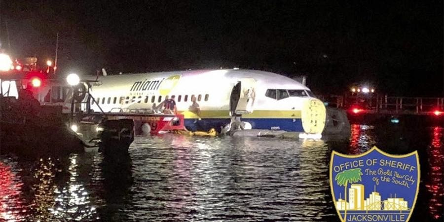 Authorities work at the scene of a plane in the water in Jacksonville in Florida