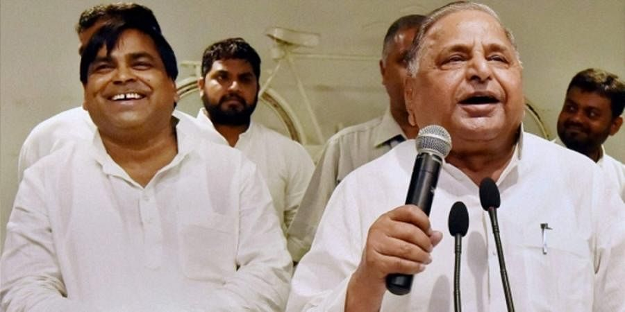 Gayatri Prajapati (left) with SP supremo Mulayam Singh Yadav. (File | PTI)