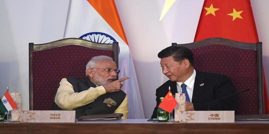 Pak must stop terror for peace talks: Modi tells Xi
