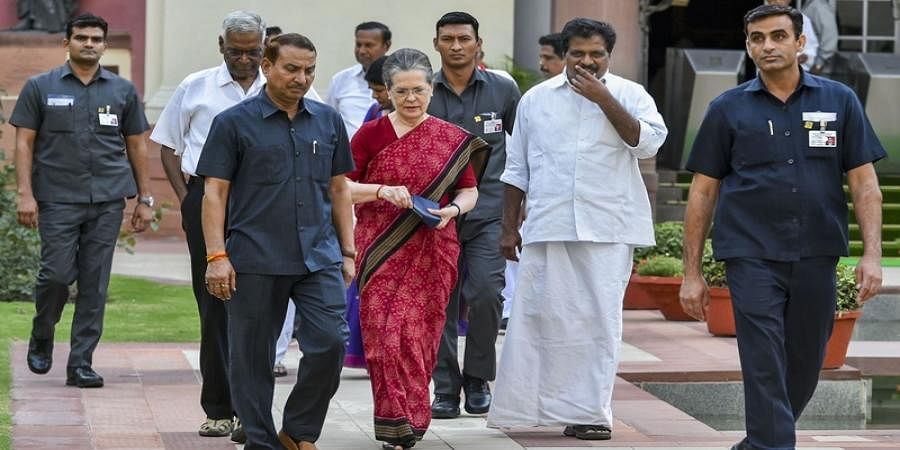 UPA chairperson Sonia Gandhi along with CPI's D Raja and other leaders arrives for a meeting to decide their strategy in Parliament in New Delhi on 18 June 2019.