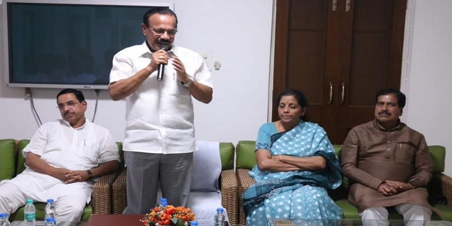 D V Sadananda Gowda in his residence along with states minister