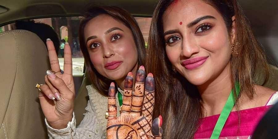 Actors and Trinamool Congress (TMC) MPs Mimi Chakraborty and Nusrat Jahan (R) at Parliament House complex during the Budget Session, in New Delhi