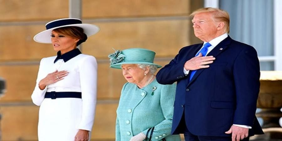 Donald Trump and his wife with England queen Elizabeth 2
