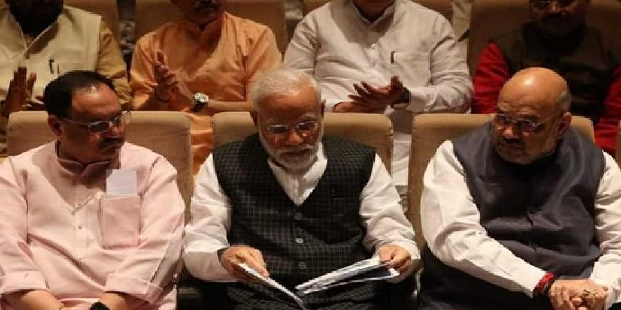 Prime minister Narendra Modi, Home minister Amit Shah (R) and BJP working president JP Nadda (L) during the BJP Parliamentary party meeting at Parliament House in New Delhi on Tuesday.