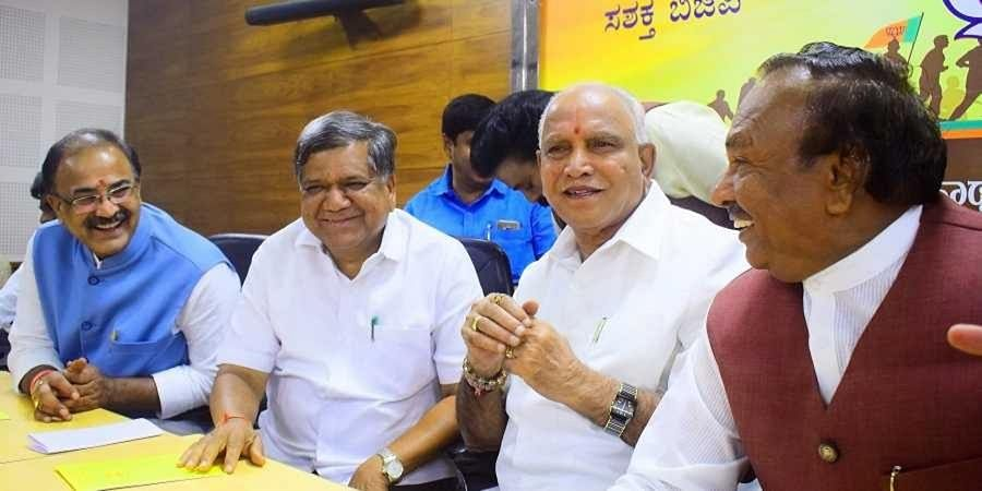 BJP Karnataka chief BS Yeddyurappa along with party members at a meeting in the BJP headquarters in Bengaluru on 9 July 2019. (Photo | Pandarinath B, EPS)