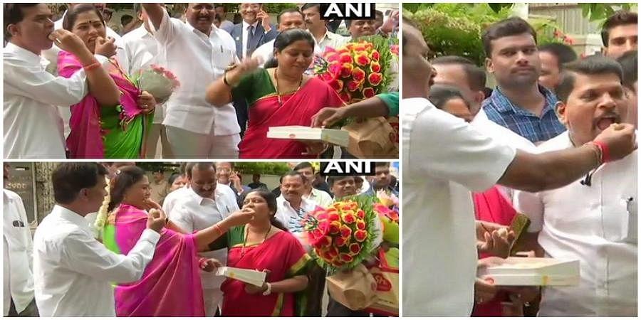 BJP workers celebrating outside B S Yedyurappa residence