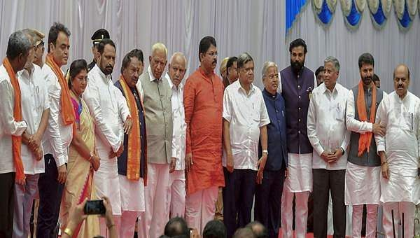 17-mlas-takes-oath-as-karnataka-cabinet-minister-in-the-presence-of-governor-vajubhai-vala-and-cm-yediyurappa