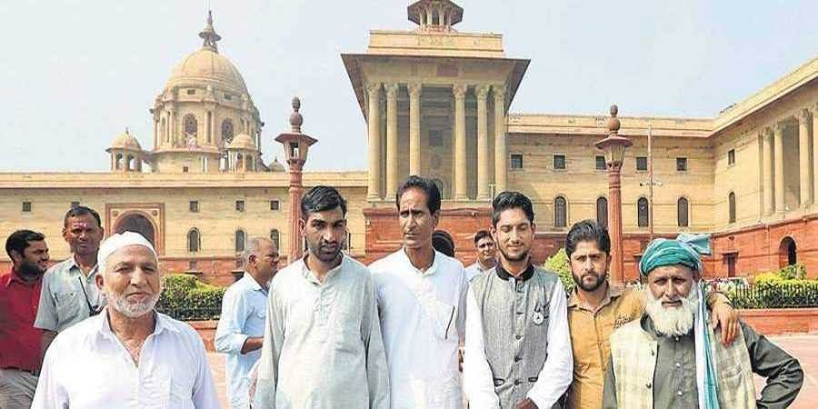 A group of sarpanchs from J&K after meeting Home Minister Amit Shah at North Block in New Delhi on Tuesday