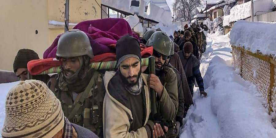 Army carries pregnant woman in waist-deep snow; she later gives birth at Baramulla hospital