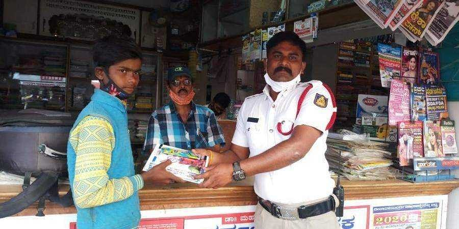 The traffic cop buying books for the student