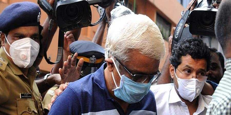 M Sivasankar enters the ED office in Kochi after being taken into custody by the central agency.