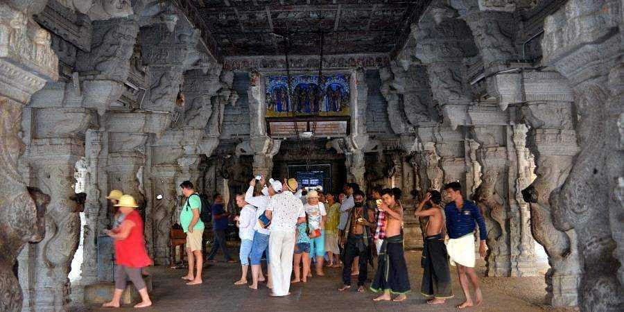 Tourists at Virupaksha temple in Hampi.