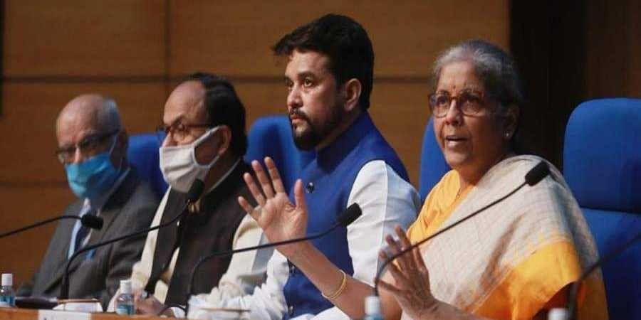 Nirmala Sitharaman along with Anurag Thakur, at a press conference in New Delhi.