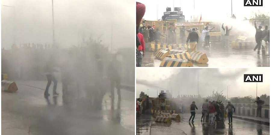 Police use water cannons, tear gas