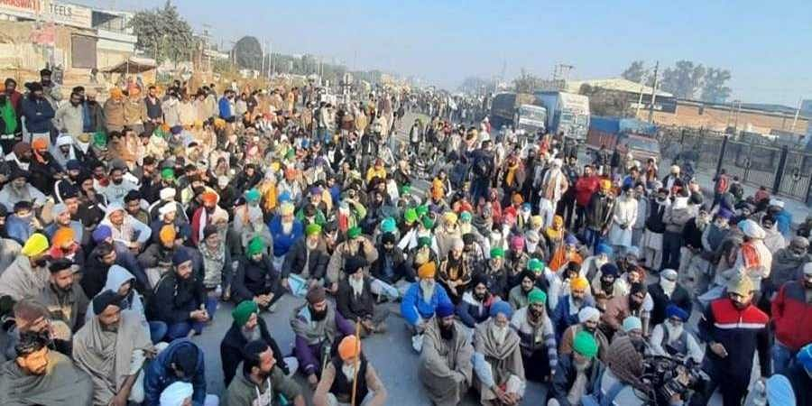 Farmers protesting at Singhu border in New Delhi on Saturday.