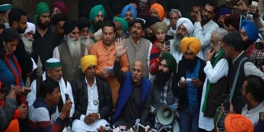 Representatives of farmer organizations address the media after a meeting regarding the farm laws near Singhu border in New Delhi on Wednesday.