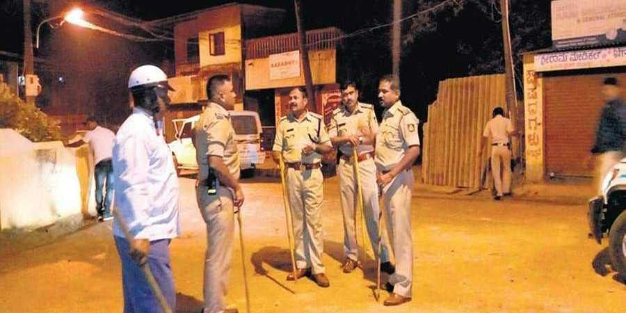 Police officers take stock of the situation in Angol, Belagavi