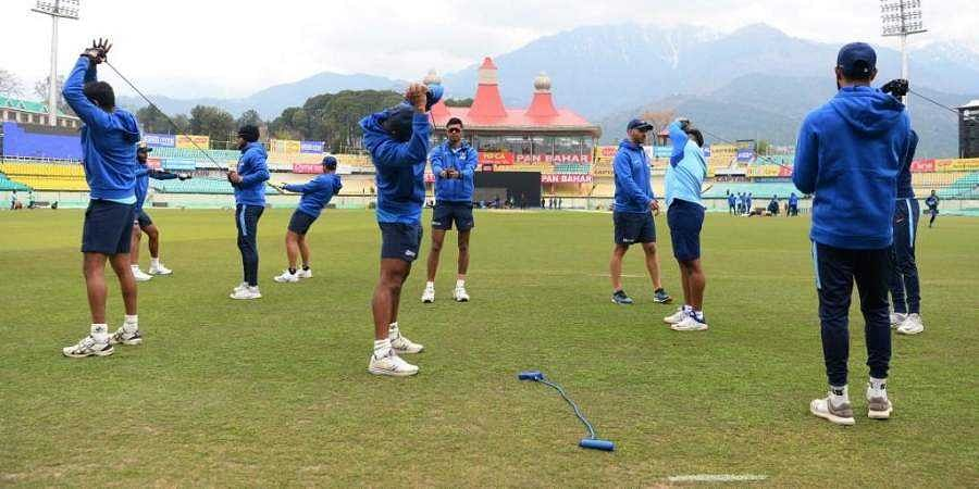 Indian cricketers attend a practice session.