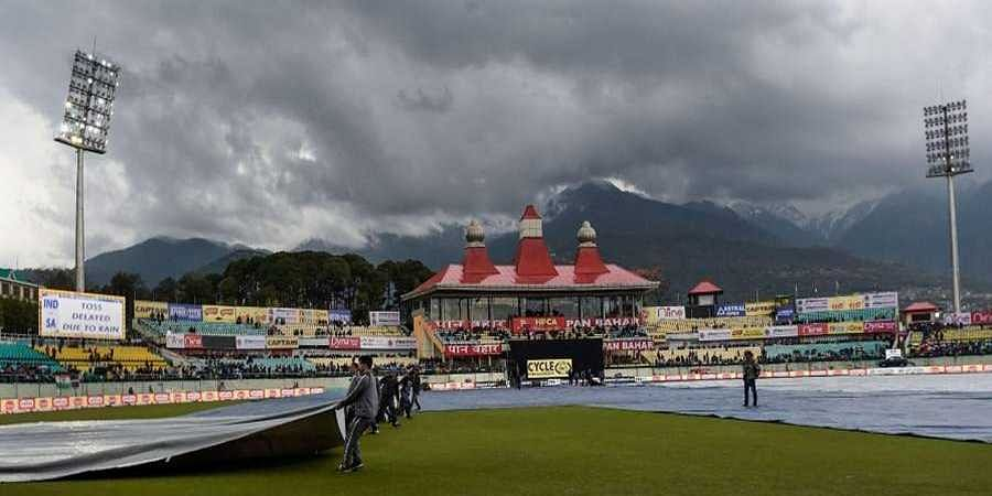 The_HPCA_Stadium_ground_is_covered_due_to_rains_in_Dharamshala1