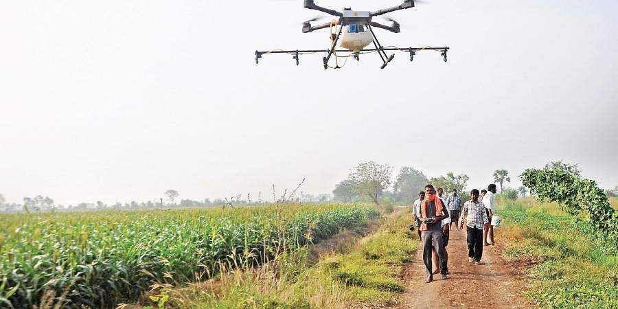 Farmers in Andhra's Namburu village use drone to spray away their worries