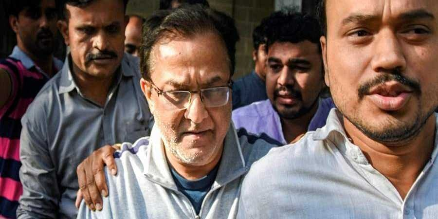 Yes Bank founder Rana Kapoor being taken to a court after being arrested by Enforcement Directorate under money laundering charges in Mumbai Sunday March 8 2020.