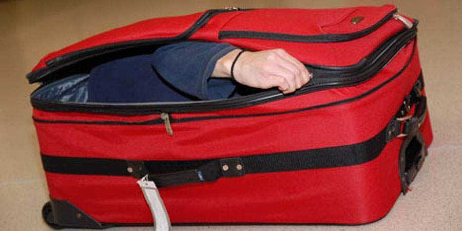 friend in suitcase