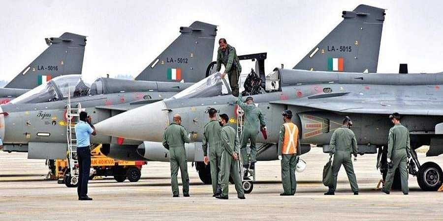 Chief of the Air Staff, Air Chief Marshal RKS Bhadauria gets down after flying the LCA Tejas MK-1 Initial Operational Clearance (IOC) fighter aircraft at Sulur Air Force Station in Coimbatore