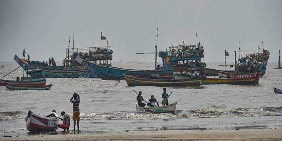 Fishing boats seen anchored at a shore following a warning by Indian Meteorological Department